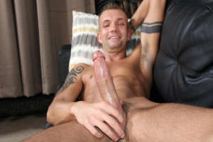 Smiling capitan wanks his big dick