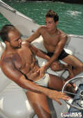 Sweet bronzed twinks slurping cocks and banging butts on a boat