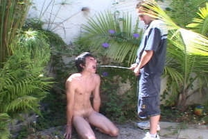 Twisted boys pissing outdoors