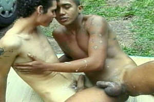 Tattooed amateur gays slurping their large pricks in the jungle